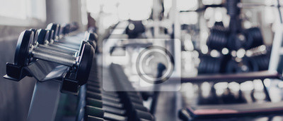 Fototapeta gym interior background of dumbbells on rack in fitness and workout room