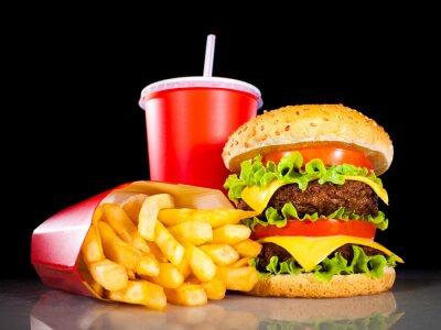 Fototapeta Hamburger smaczne i frytkami na ciemnym