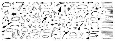 Hand drawn doodle design elements, black on white background. Swishes, swoops, emphasis, Arrow, crown, brush stroke. doodle sketch design elements