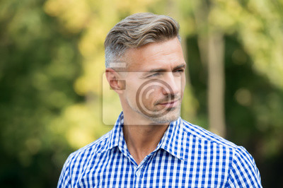 Fototapeta Handsome and confident. Handsome man on summer outdoor. Mature person with handsome face. Fashion and style. Grooming and style for older men. Handsome and well groomed