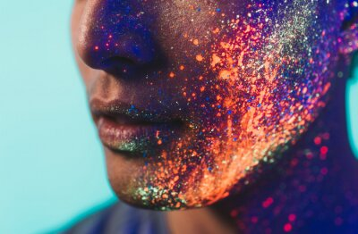 Fototapeta Handsome boy dancing at the rave party with fluorescent paintings on his face