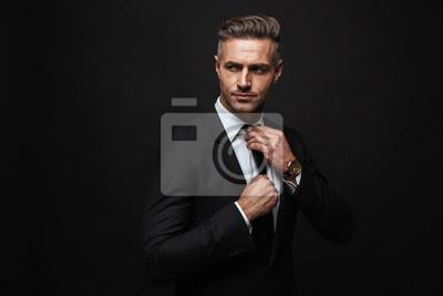 Fototapeta Handsome confident businessman wearing suit