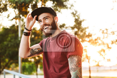 Fototapeta Handsome young man dressed in casual clothing
