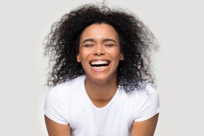Fototapeta Happy African American woman with healthy smile laughing, having fun