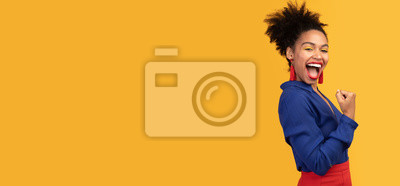 Fototapeta Happy afro woman triumphing with raised hands