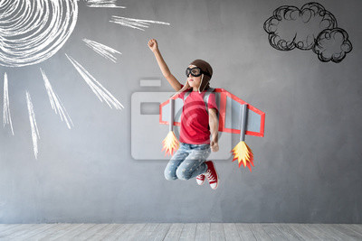 Fototapeta Happy child playing with toy jetpack