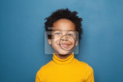 Fototapeta Happy child portrait. Little african american kid boy on blue background