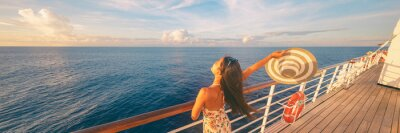 Fototapeta Happy cruise woman relaxing on deck feeling free watching sunset from ship on Caribbean travel vacation. Panoramic banner of sea and boat.