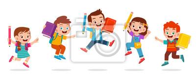 Fototapeta happy cute kids boy and girl jump