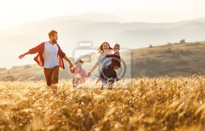 Fototapeta Happy family father of mother and child son  on nature at sunset