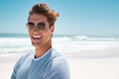 Fototapeta Happy laughing man at beach