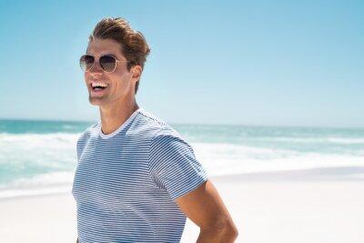 Fototapeta Happy man smiling at beach