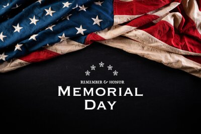 Fototapeta Happy Memorial Day. American flags with the text REMEMBER & HONOR against a blackboard background. May 25.