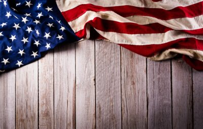 Fototapeta Happy memorial day concept made from american flag on old wooden background.