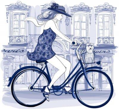 Fototapeta Happy młody rowerzysta jedzie na ulicy