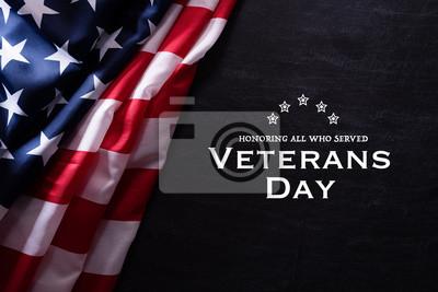 Fototapeta Happy Veterans Day. American flags veterans against a blackboard background.