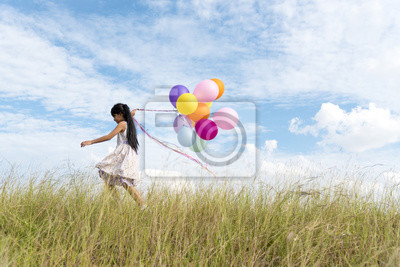 happy-woman-jumping-with-air-balloons-on