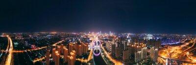 Fototapeta High Angle View Of City Lit Up At Night