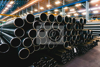 Fototapeta high quality Galvanized steel pipe or Aluminum and chrome stainless pipes in stack waiting for shipment  in warehouse