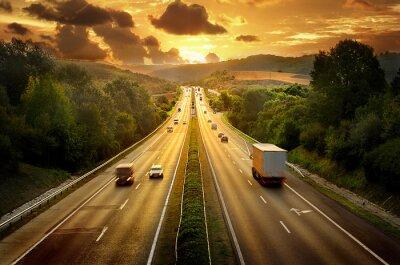Fototapeta Highway trafin w zachodzie słońca