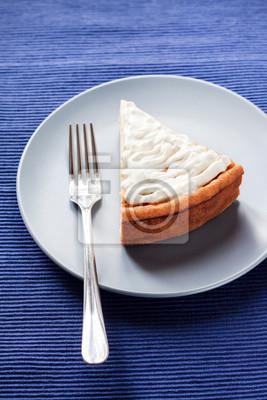 Fototapeta Homemade cheesecake with cream on a plate
