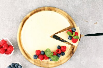 Fototapeta Homemade cheesecake with fresh raspberries and mint for dessert - healthy organic summer dessert pie cheesecake. Vanilla Cheese Cake for dessert