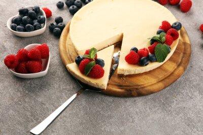 Homemade cheesecake with fresh raspberries and mint for dessert - healthy organic summer dessert pie cheesecake. Vanilla Cheese Cake for dessert