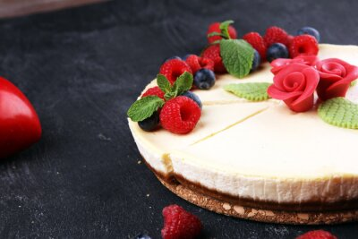 Fototapeta Homemade cheesecake with fresh raspberries and mint for valentines day - healthy organic summer dessert pie cheesecake. Vanilla Cheese Cake for dessert