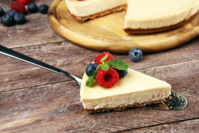 Homemade cheesecake with fresh raspberries and mint for valentines day - healthy organic summer dessert pie cheesecake. Vanilla Cheese Cake for dessert