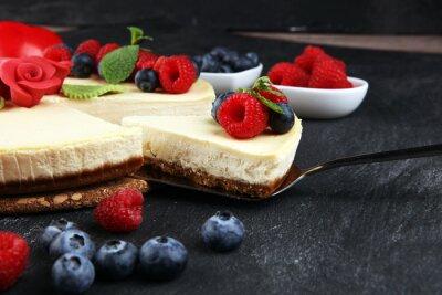 Fototapeta Homemade cheesecake with fresh raspberries and mint for valentines day - healthy organic summer dessert pie cheesecake. Vanilla Cheese Cake for dessert