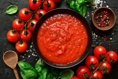 Fototapeta Homemade tomato sauce passata - traditional recipe of italian cuisine.Top view with copy space.