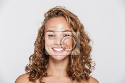 Fototapeta Image of happy half-naked woman smiling and looking at camera