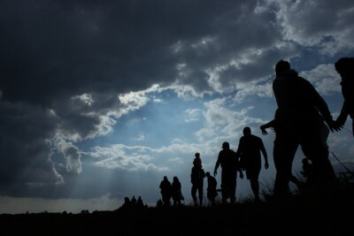 Fototapeta Immigration of people blue sky with dark clouds