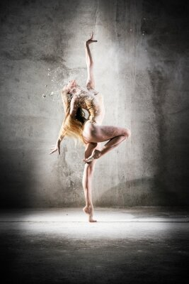 Fototapeta  Incredibly beautiful pose of a dancer with flour. Beautiful girl ballerina with blond hair. Dance, emotion, pose, feet, ballet, modern, contemporary, theater, fitness figure, balance, body aesthetics