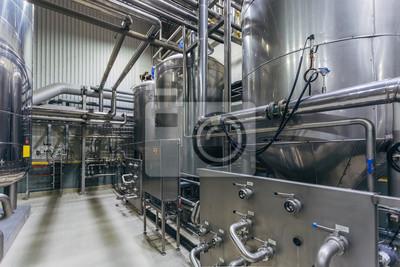 Fototapeta Industrial stainless steel vats in modern brewery