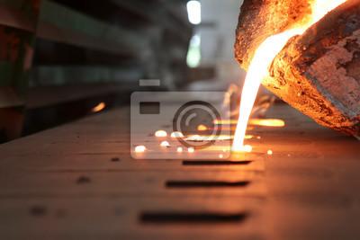 Fototapeta Iron molten metal pouring in sand mold