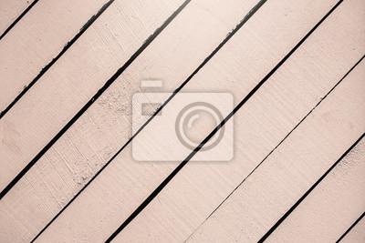 Fototapeta Jasnoróżowa drewniana powierzchnia, tekstury zakończenie. Nieociosane naturalne diagonalne deski z pęknięciami, rysy dla nowożytnego projekta, wzory, tło, kopii przestrzeń