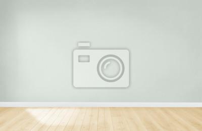 Fototapeta Jasnozielona ściana w pustym pokoju z drewnianą podłogą