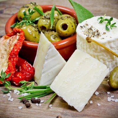 Fototapeta Käse und Oliven