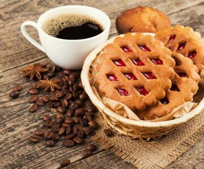 Fototapeta kawa i ciasteczka na tle drewna