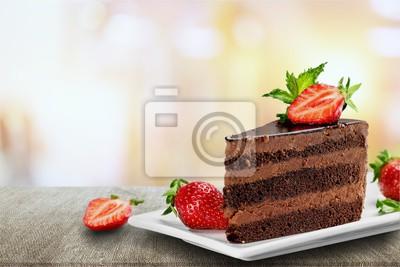 Fototapeta Kawałek pyszne ciasto czekoladowe na biurku