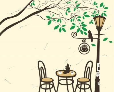Fototapeta Kawiarnia na świeżym powietrzu pod drzewem z latarnią