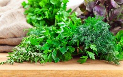 Fototapeta Kitchen herbs on wooden table