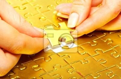 Kobieta palców gospodarstw złota puzzle