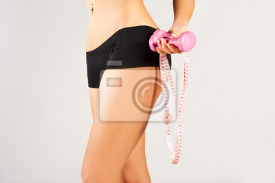 Kobieta pomiaru idealne ciało, zdrowy styl życia koncepcji
