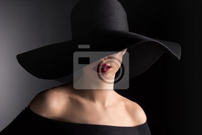 Fototapeta Kobieta w czarnym kapeluszu
