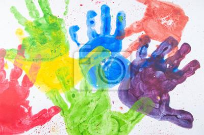 Fototapeta Kolorowe farby ręcznie z rąk dzieci na białym papierze