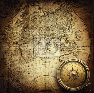 Kompas na mapie vintage. Przygoda, podróże, historie tła.