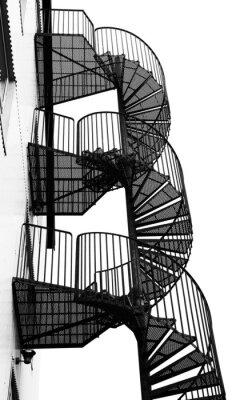 Fototapeta Kręte metalowe schody, czarno-biały obraz.