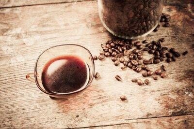 Fototapeta Kubek czarnej kawy z fasoli